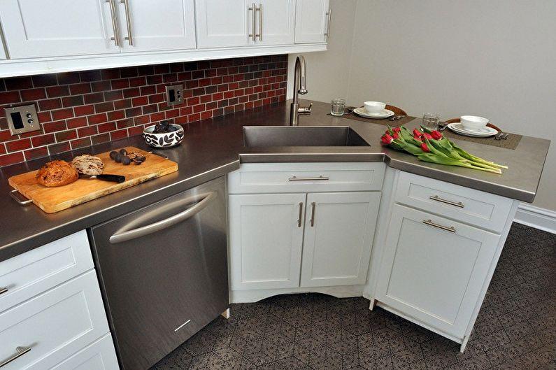 Стильно, функционально и необычно: угловая мойка для кухни